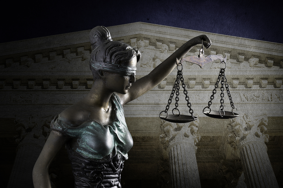 Lady Justice against the Supreme Court of U.S. background
